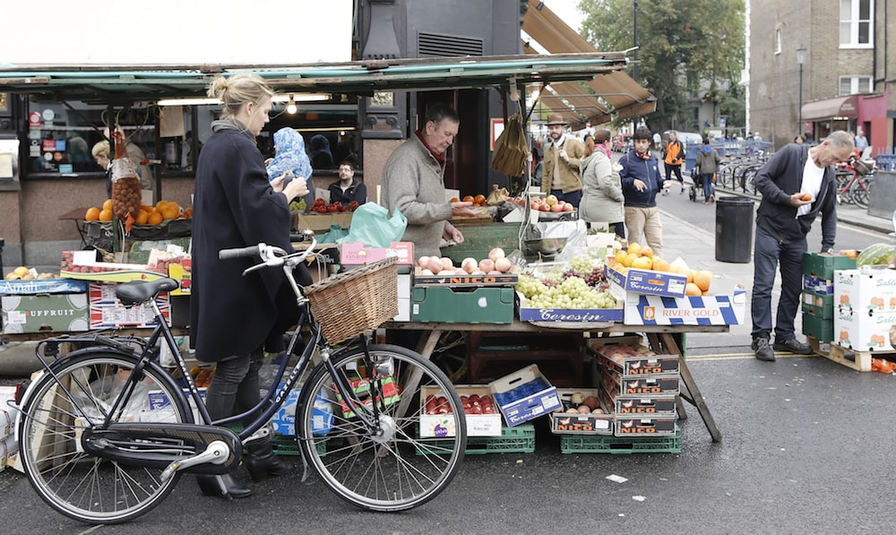 a lady at a market stall