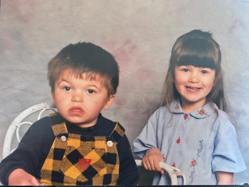 This is a family photo of Amy and Ross as children