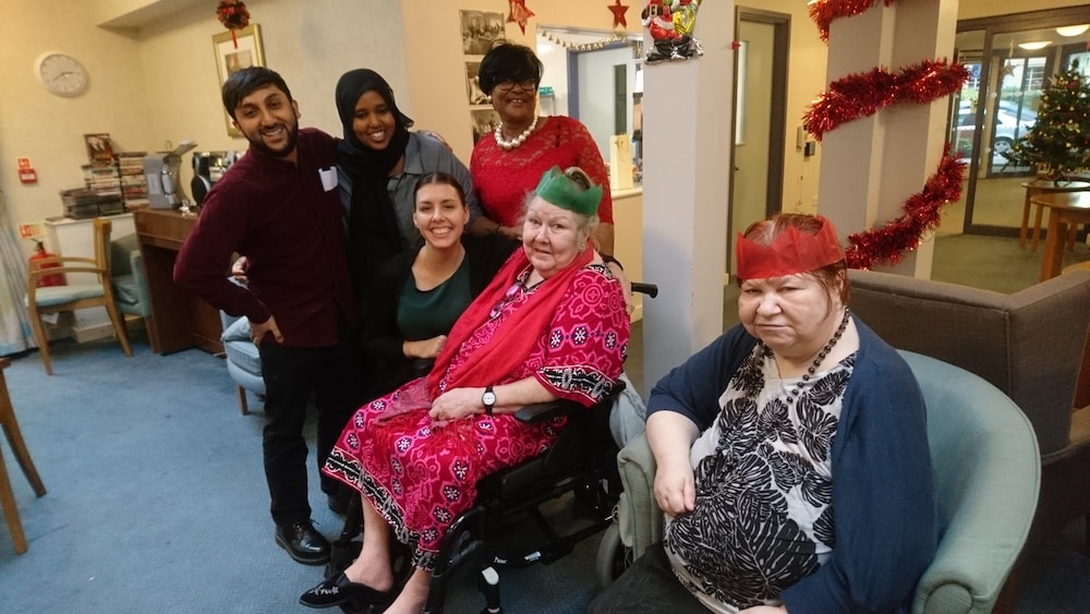 This is a photo of Mohammad with a few residents at Ester Randall Court at Christmas time