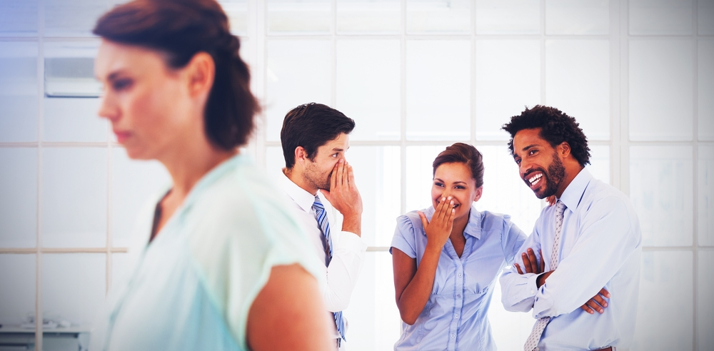 This is photo of people at work laughing at a colleague