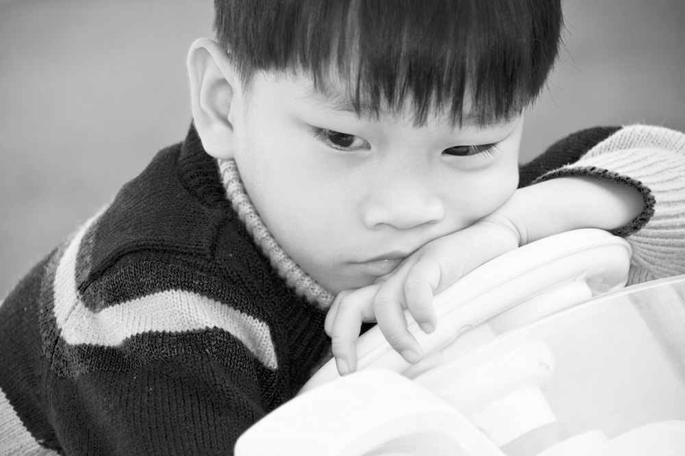 A young boy looking upset