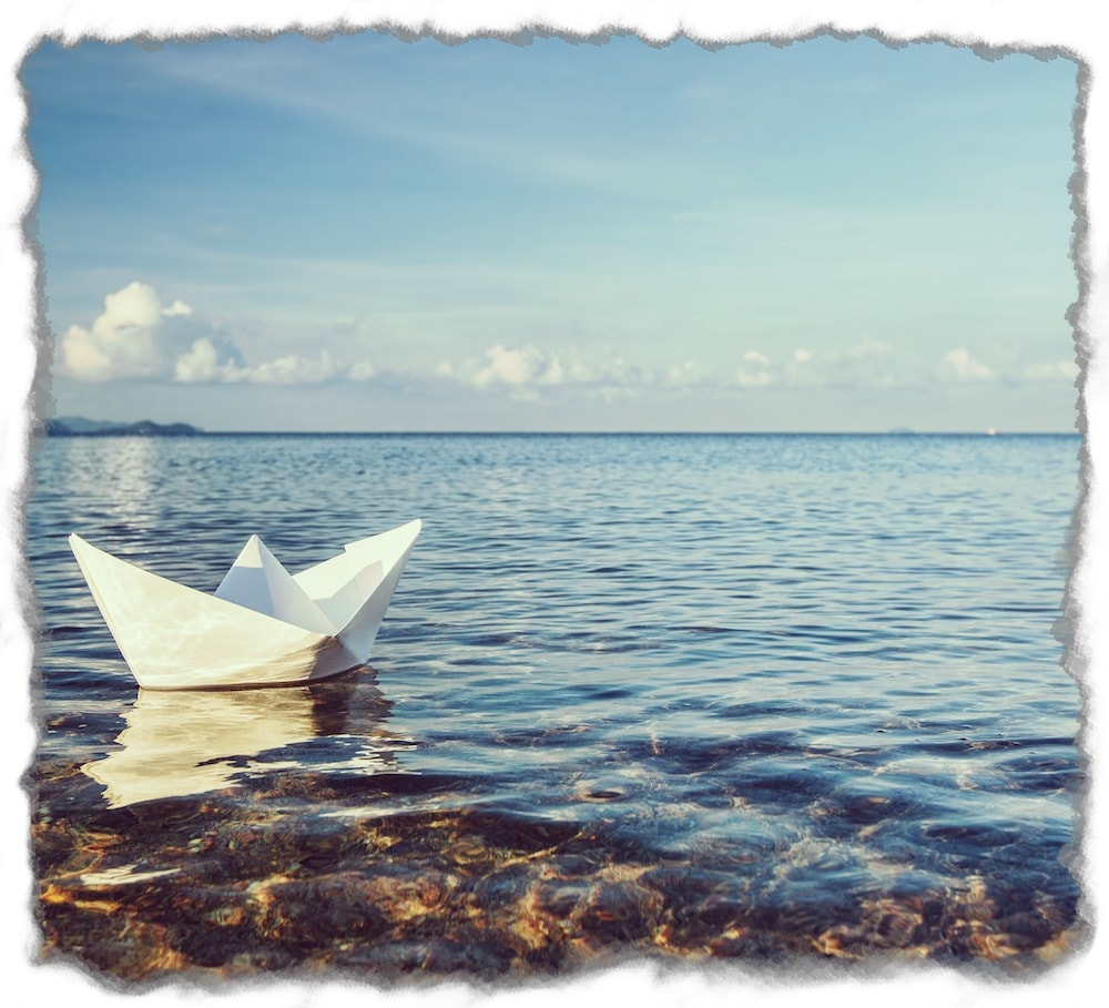Paper Boat Floating on the Sea