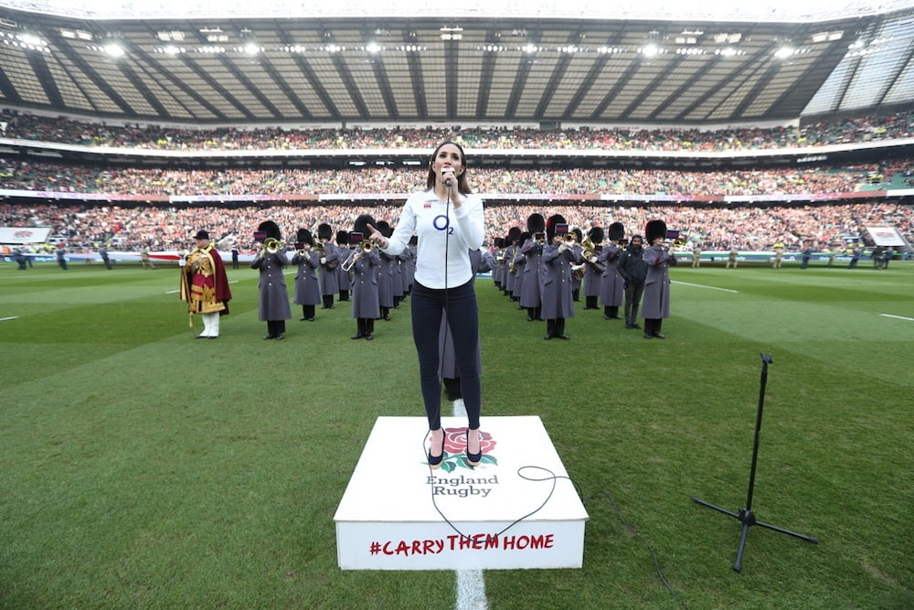 Laura singing for England Rugby