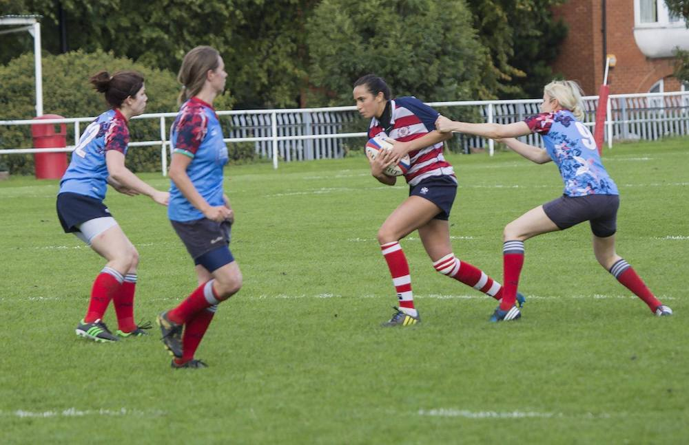 Laura playing rugby