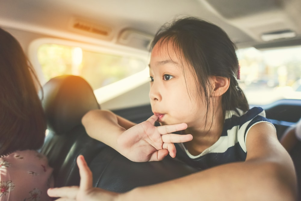 child worried in car