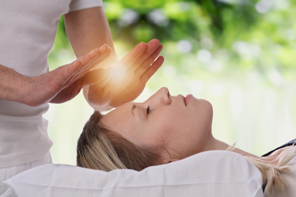 Woman getting Reiki massage