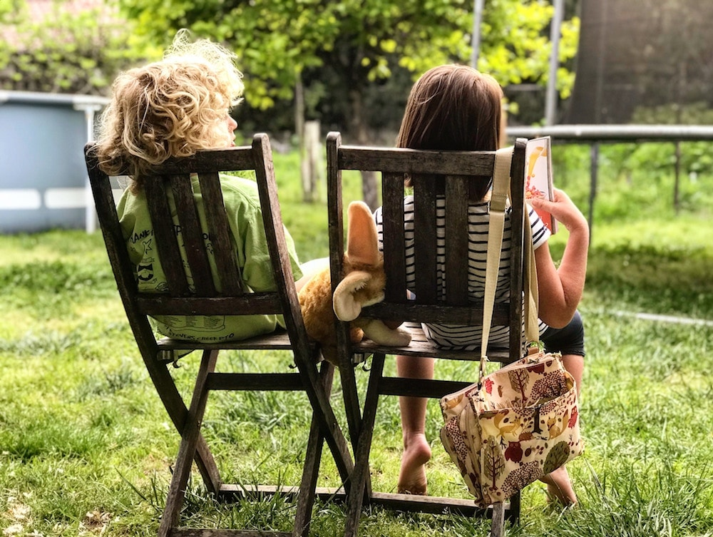 children sat together in garden