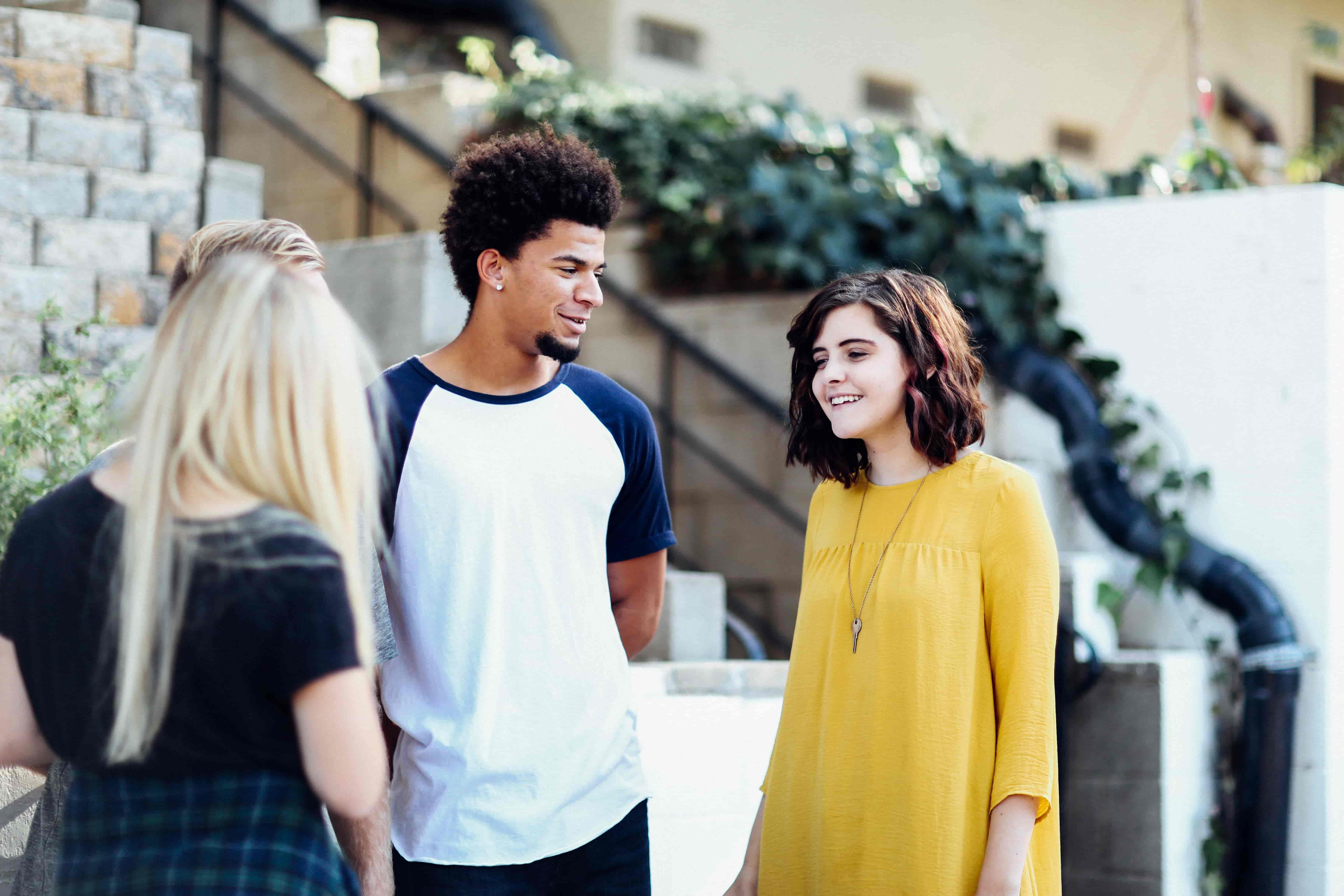 teens-smile-and-chat-together-outside