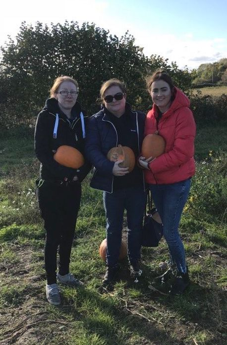 Rosie pumpkin picking with her family