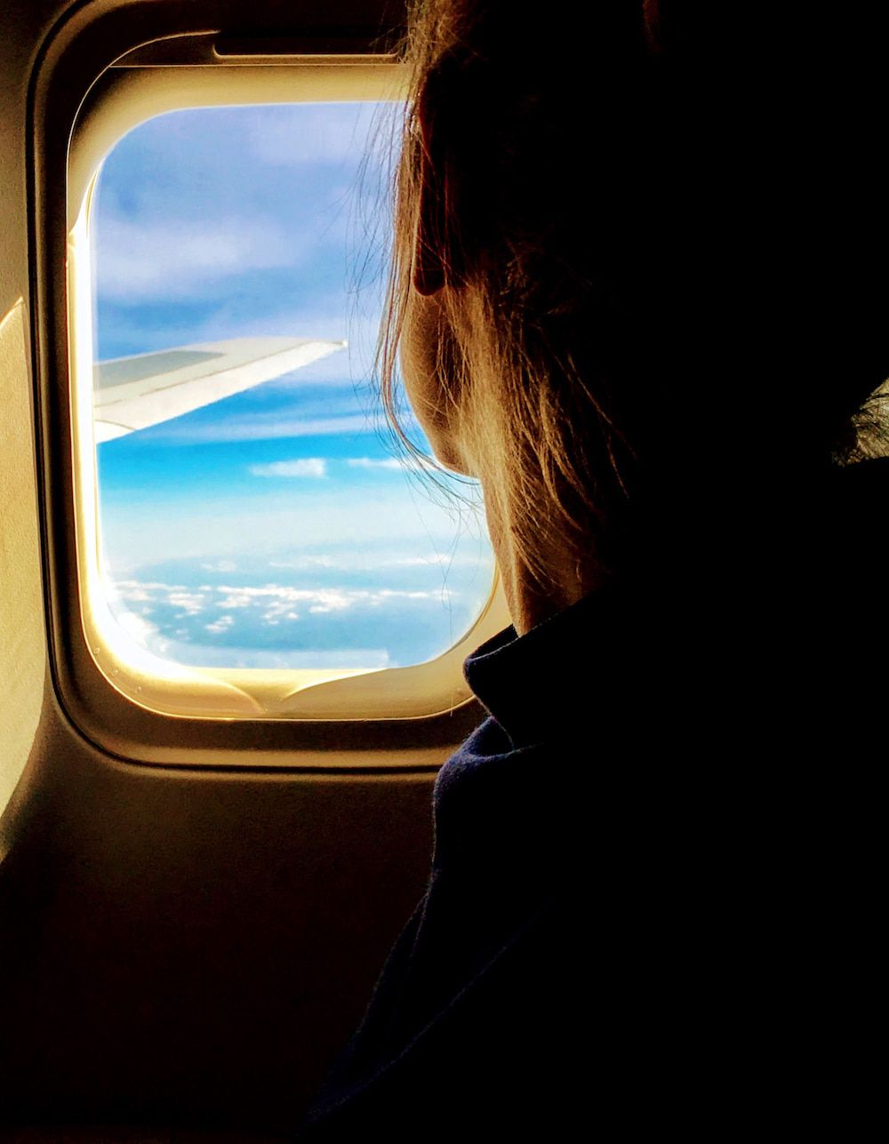 looking out of the window on a plane