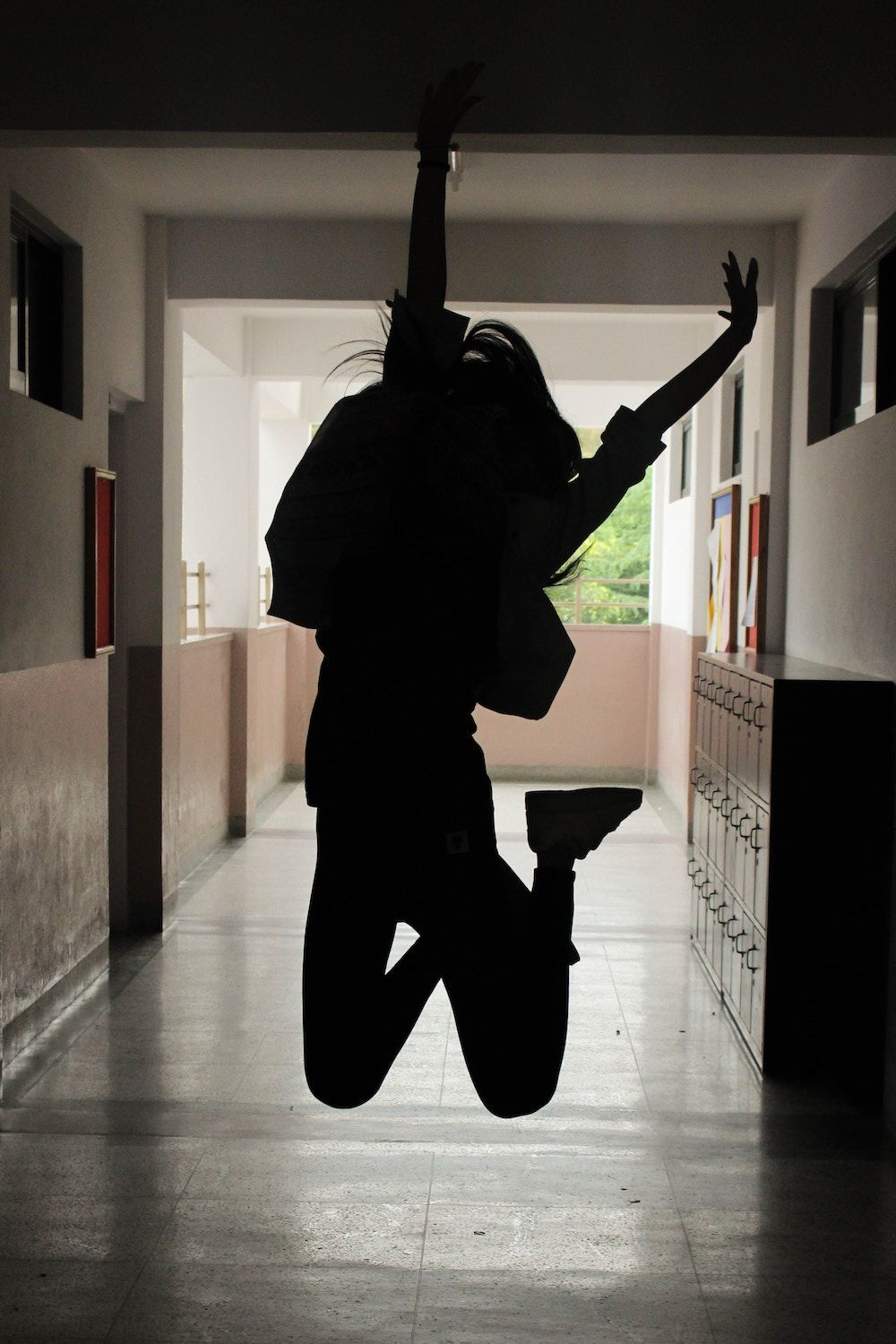 girl at school jumping