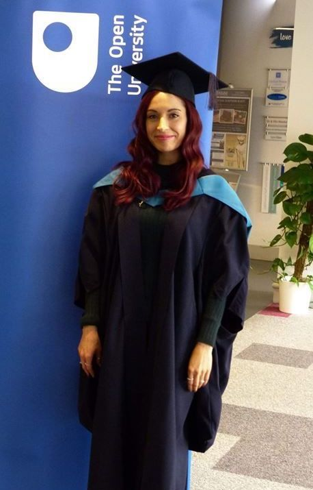 Vikki in her cap and gown at her graduation ceremony