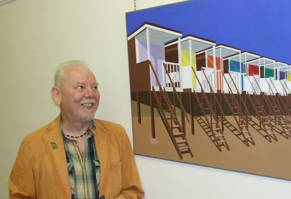 Brian looking at his artwork in a gallery
