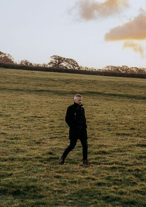 Jonathan walking in a field