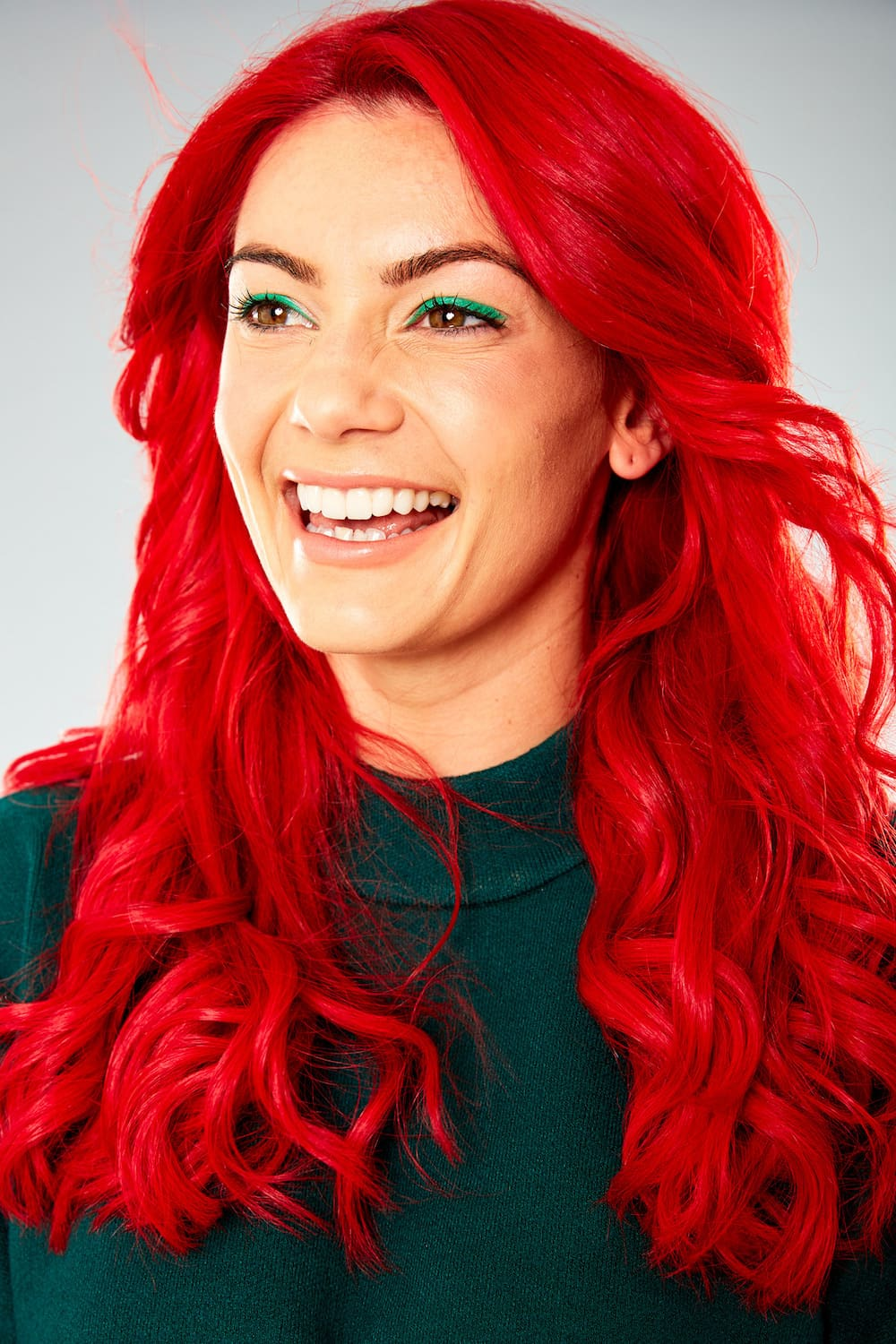 Dianne Buswell smiling, looking away from the camera