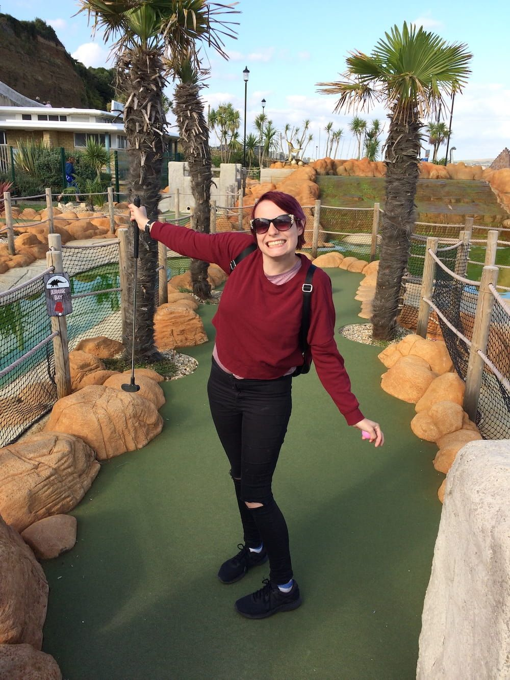 Stacey smiling playing mini golf