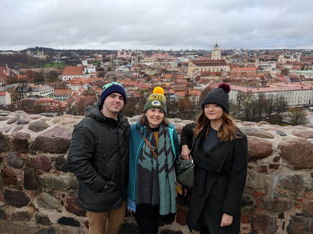 Richard, his partner, Megan, and their close friend, Laura, exploring the wintry sights of Vilnius, Lithuania