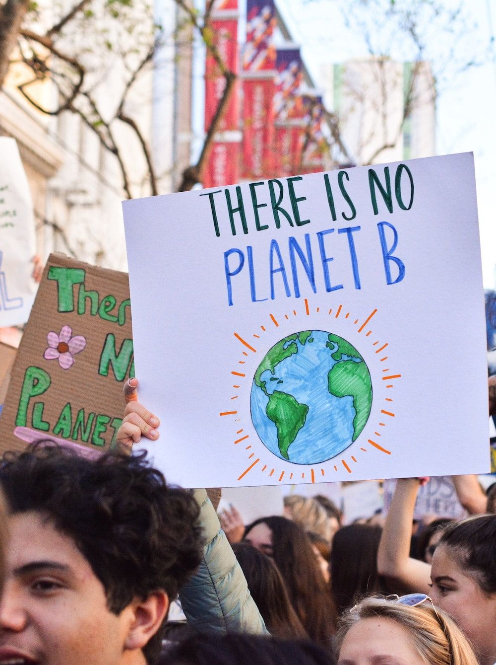 protestors with sign that reads 'there is no planet b'