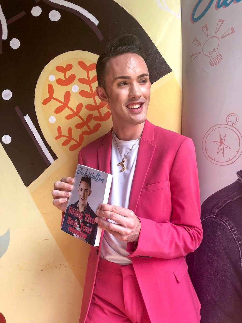 Jack holding his book titled 'Being the Best You'