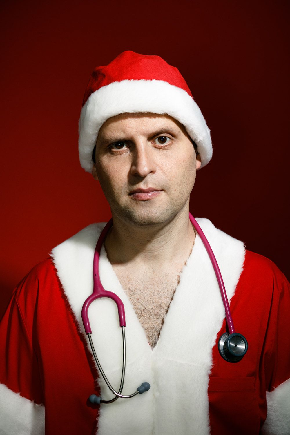Adam Kay wearing a santa suit and hat