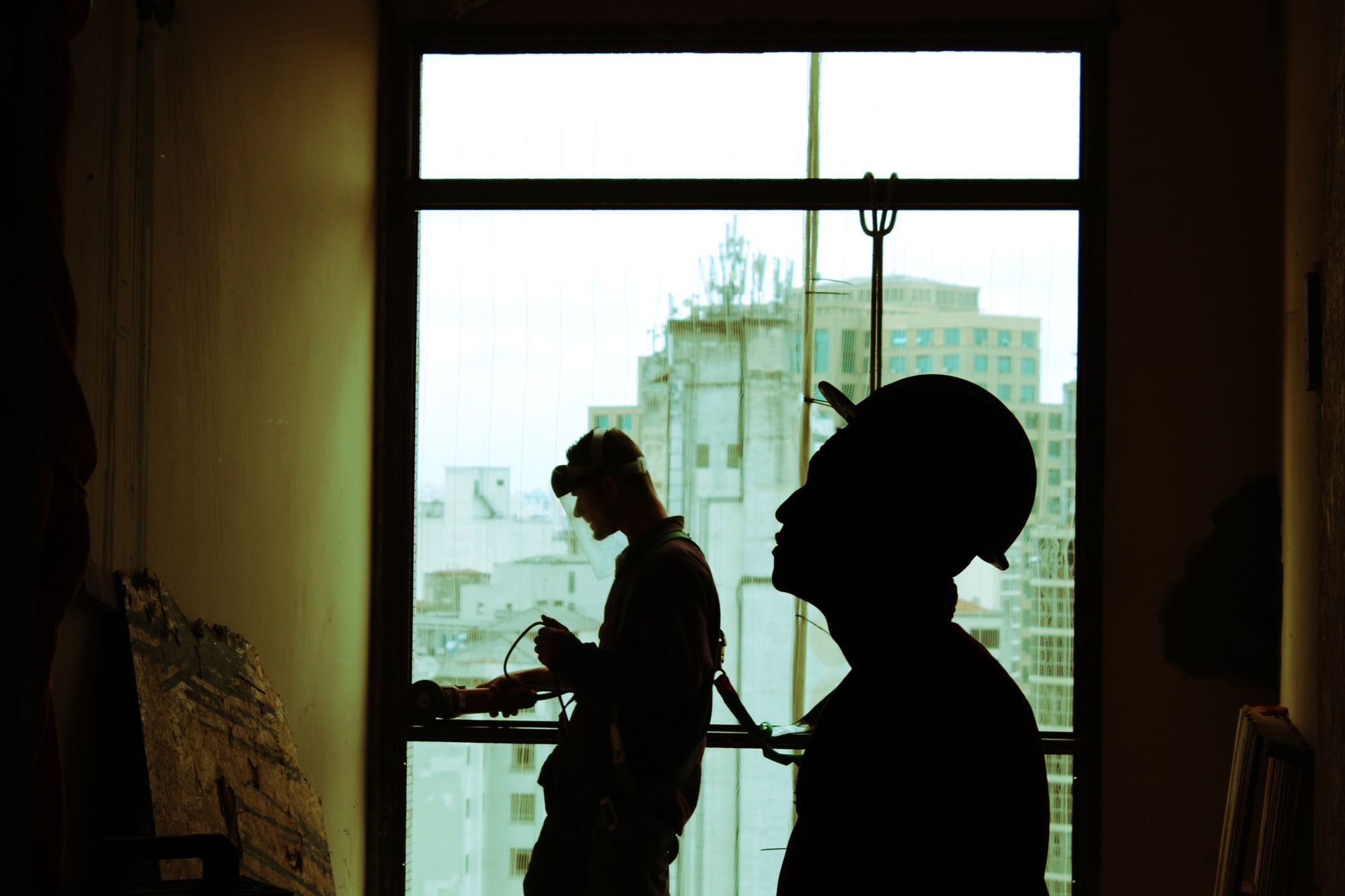 Silhouette of two workers on a building site