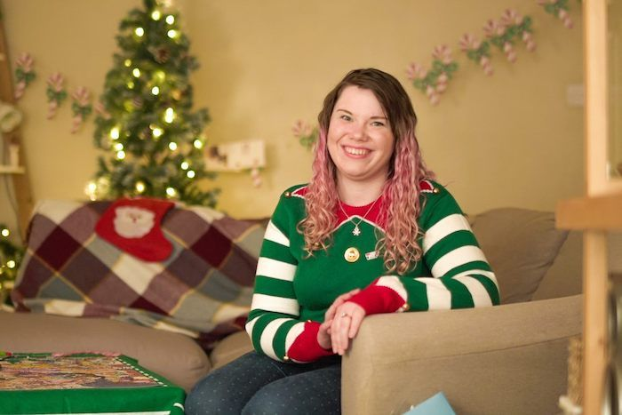 Photo of Lucy smiling at home during Christmas