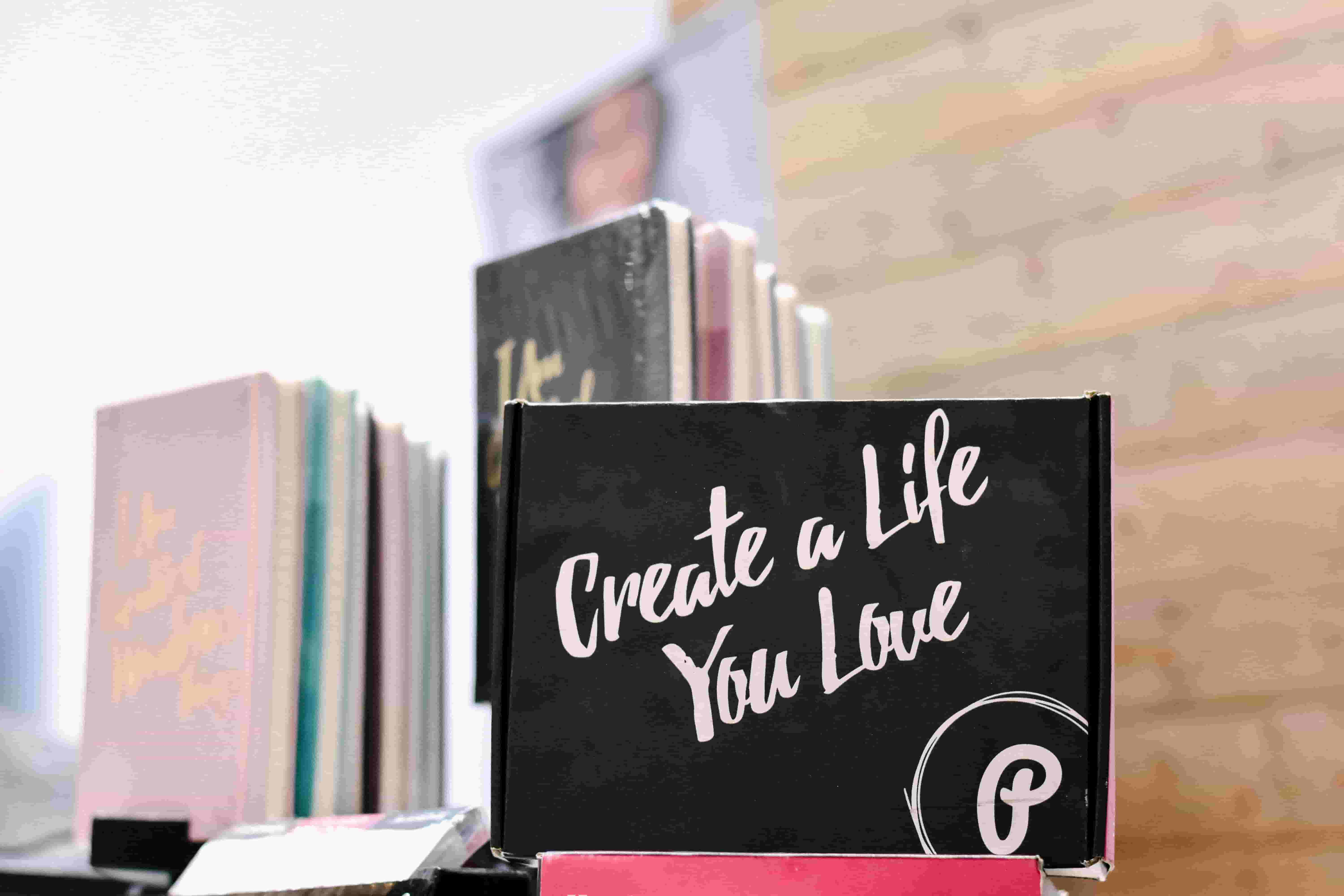 A box is displayed with an inspirational message, saying: Create a life you love
