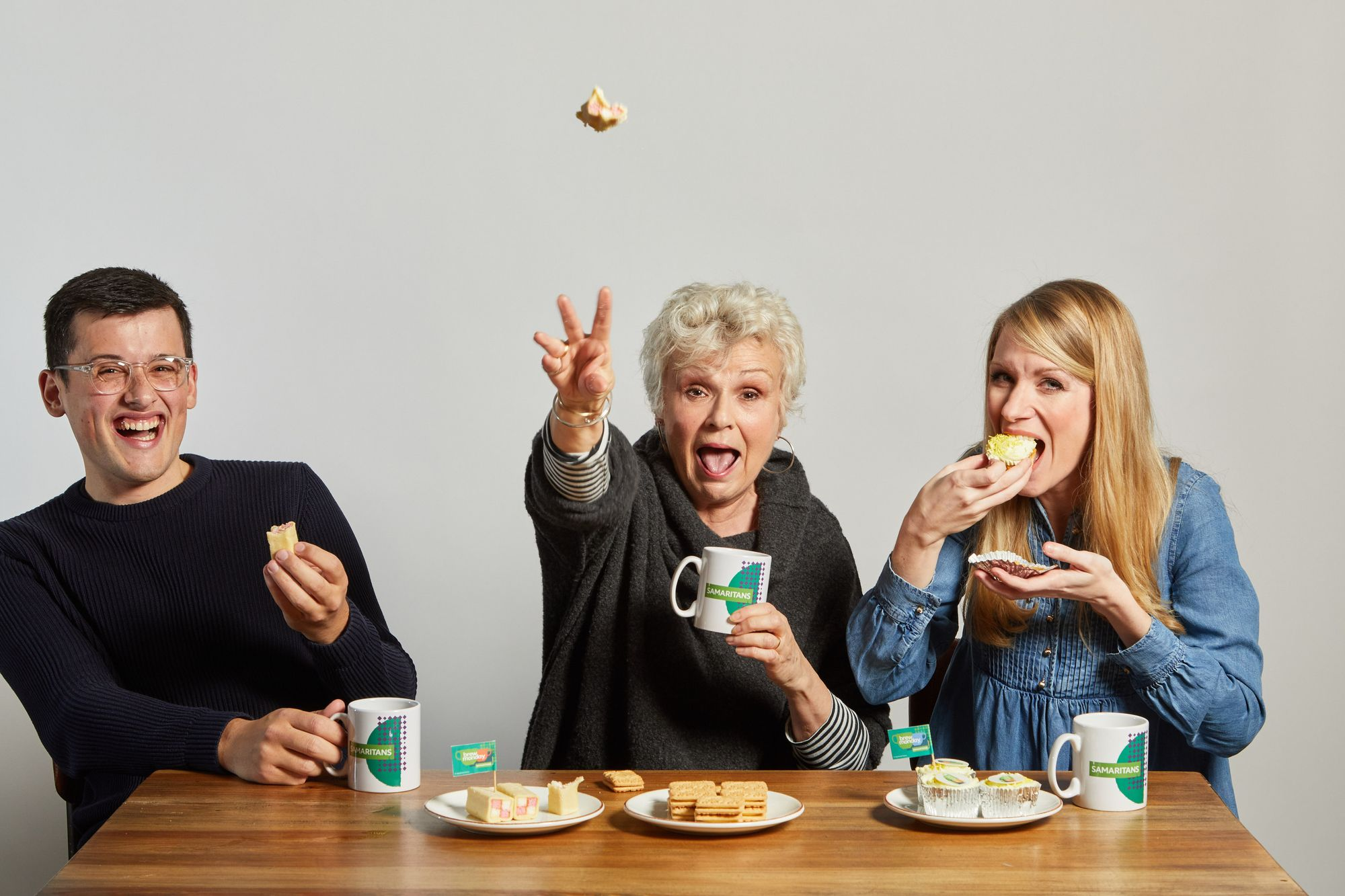 Michael Chakraverty, Dame Julie Walters and Rachel Parris share a cup of tea and cake together in support of Brew Monday