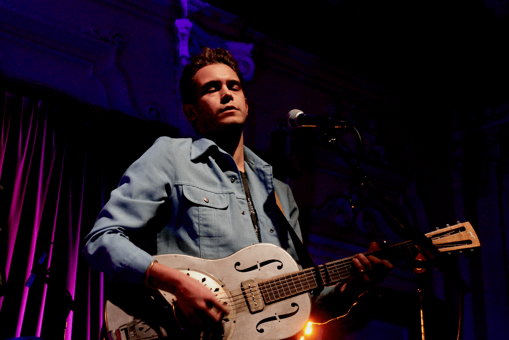 Henry in 2019 performing at Bush Hall fundraising for Young-Minds