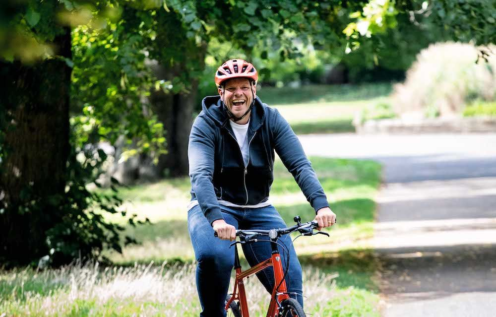 Tom cycling outdoors