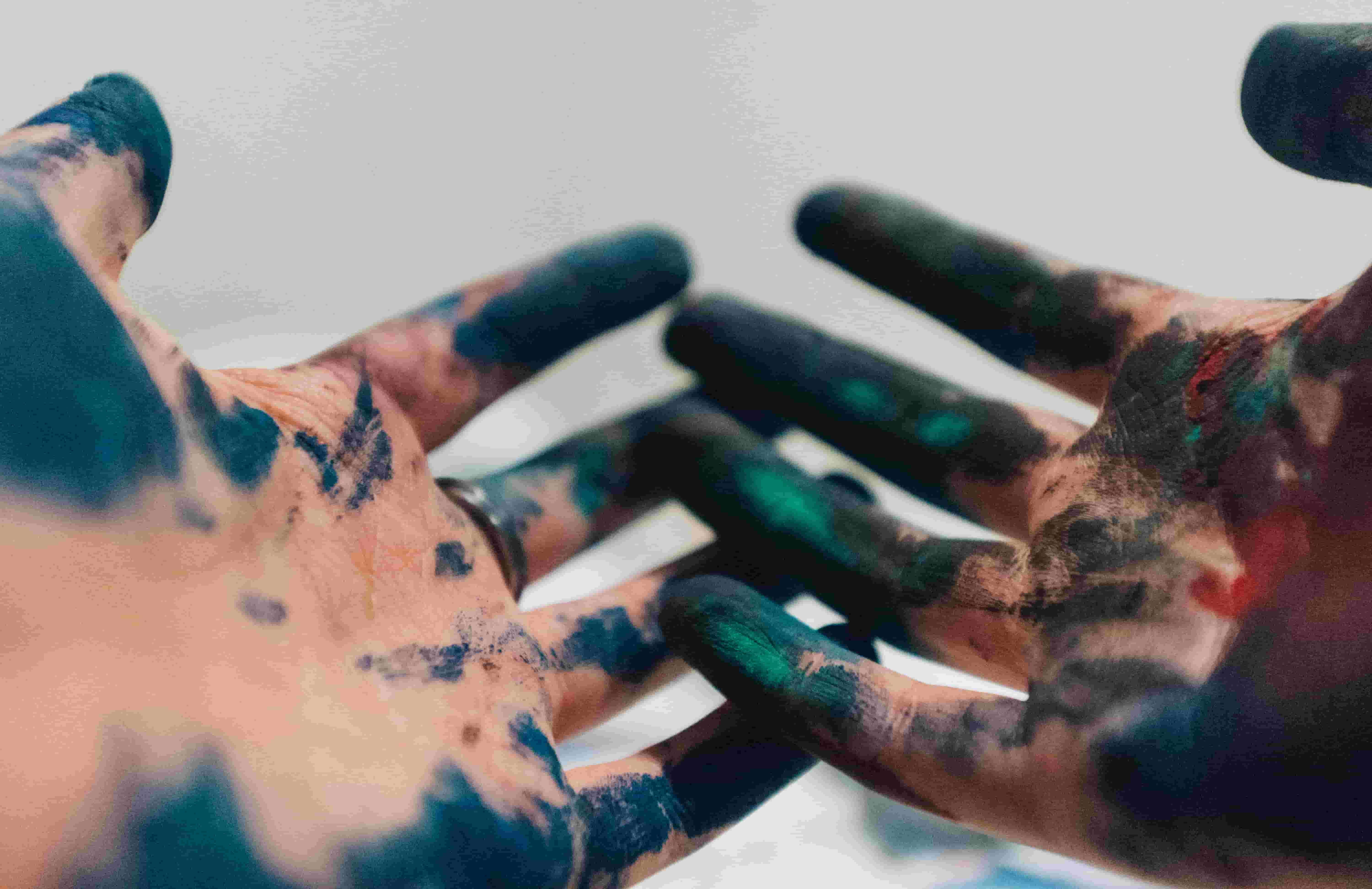 Close-up of paint covered hands