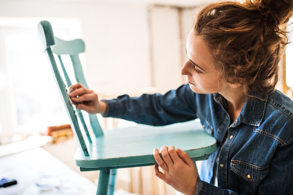 woman painting chair
