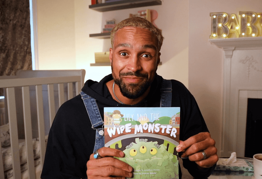 Ashley holding a copy of Lily and the Wipe Monster