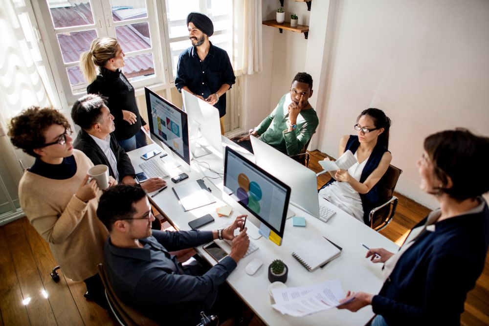 group of people working at an office
